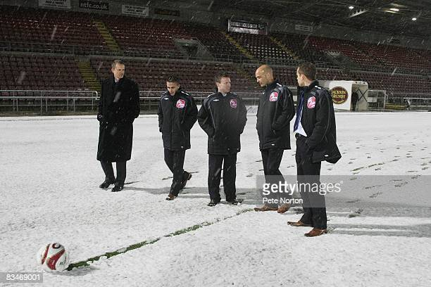 Referee Darren Drysdale inspects the pitch prior to postponing the Coca Cola League One match between Northampton Town and Colchester United at the...
