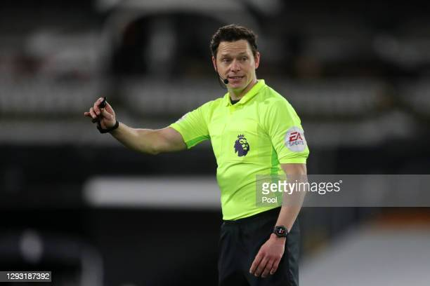 Referee Darren England reacts during the Premier League match between Fulham and Southampton at Craven Cottage on December 26, 2020 in London,...