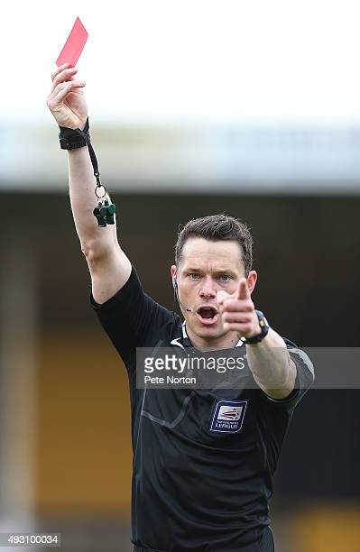 Referee Darren England shows a red card during the Sky Bet League Two match between Cambridge United and Northampton Town at Abbey Stadium on October...