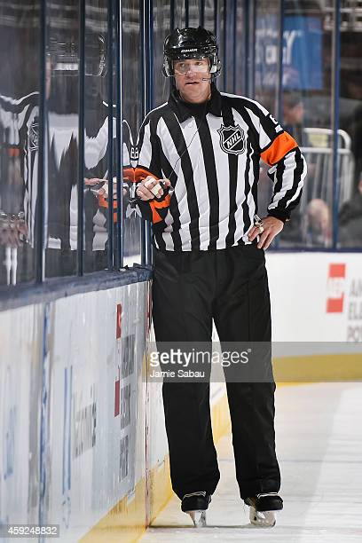 NHL referee Dave Jackson consults with the video judge on a goal call during a game between the Columbus Blue Jackets and the Detroit Red Wings on...