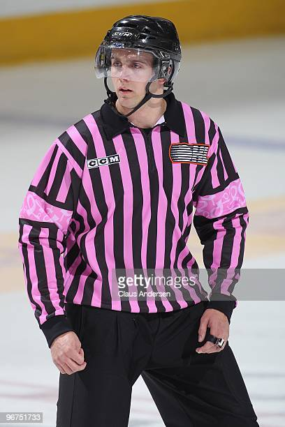 Referee Dave Lewis wears the special pink Breast Cancer uniform during a game between the Barrie Colts and Peterborough Petes on February 11 2010 at...