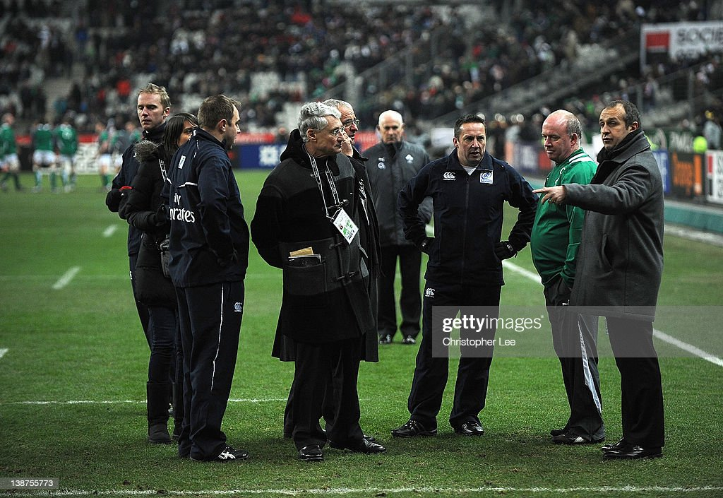 Referee Dave Pearson (3rd from R), Ireland Coach Declan Kidney (2nd R) and France Coach Philippe Saint Andre talk just before kick off during the RBS 6 Nations match between France and Ireland at Stade de France on February 11, 2012 in Paris, France.