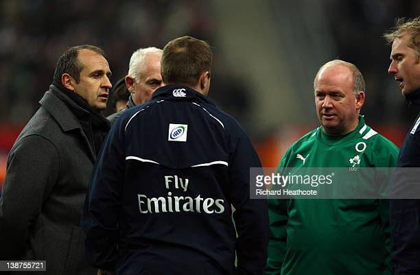 Referee Dave Pearson speaks to France Coach Philippe SaintAndre and Ireland coach Declan Kidney as the match is called off just before kick off due...
