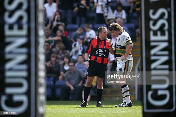 Referee Dave Pearson speaks with Dylan Hartley of Northampton during the Guinness Premiership match between London Wasps and Northampton Saints at...