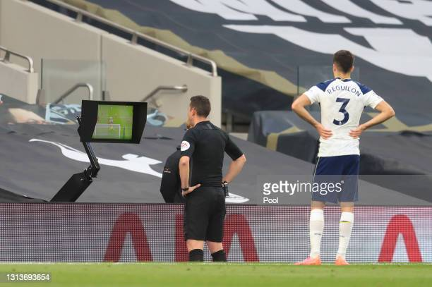 Referee David Coote reviews the VAR screen before disallowing a goal scored by Son Heung-Min of Tottenham Hotspur for offside during the Premier...
