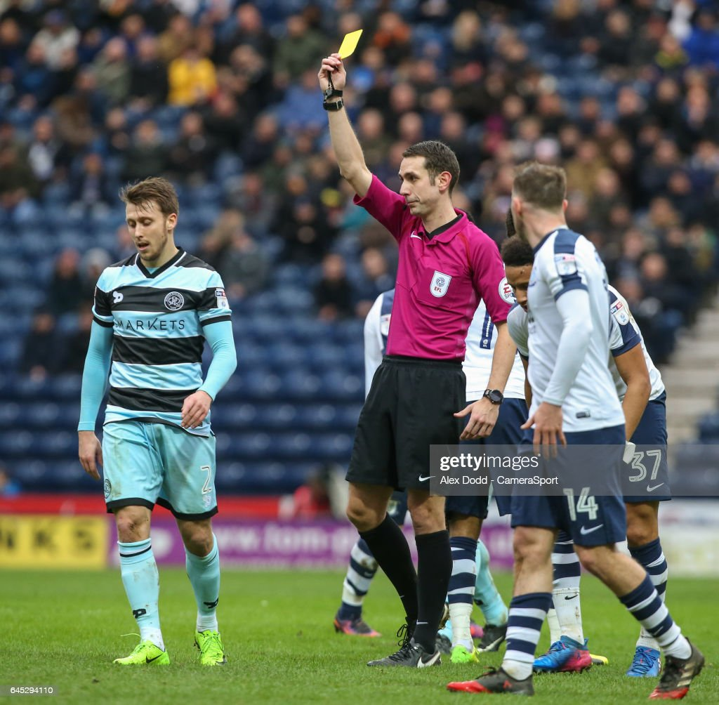 Referee David Coote shows Queens Park Rangers' Luke Freeman the yellow card during the Sky Bet Championship match between Preston North End and Queens Park Rangers at Deepdale on February 25, 2017 in Preston, England.