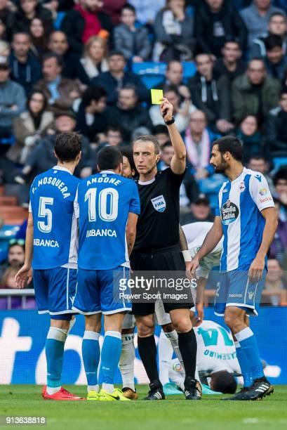 Referee David Fernandez Borbalan shows Florin Andone of RC Deportivo La Coruna the yellow card during the La Liga 201718 match between Real Madrid...