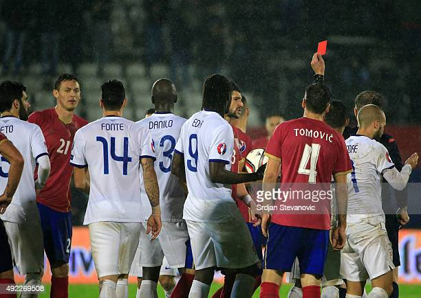 Referee David Fernandez Borbalian of Spain show red card to the Nemanja Matic of Serbia during the Euro 2016 qualifying football match between Serbia...