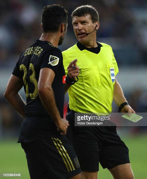Referee David Gantar explains a call to Laurent Ciman of Los Angeles FC during first half of the the MLS match between Real Salt Lake and Los Angeles...