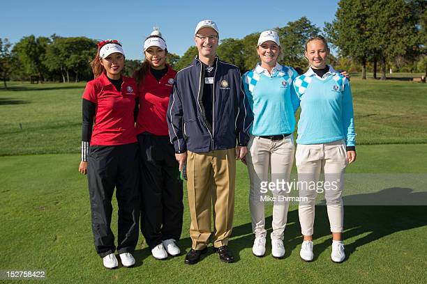 Referee David McAtee poses with Esther Lee and Alison Lee of the United States Team Linnea Strom of Sweden and Emily Pedersen of Denmark from the...