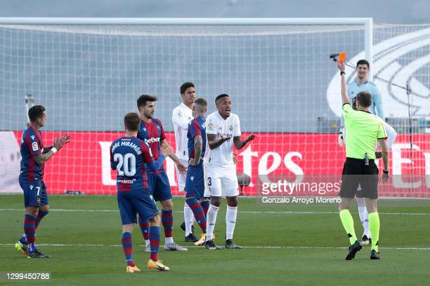 Referee David Medie Jimenez awards Eder Militao of Real Madrid a red card during the La Liga Santander match between Real Madrid and Levante UD at...