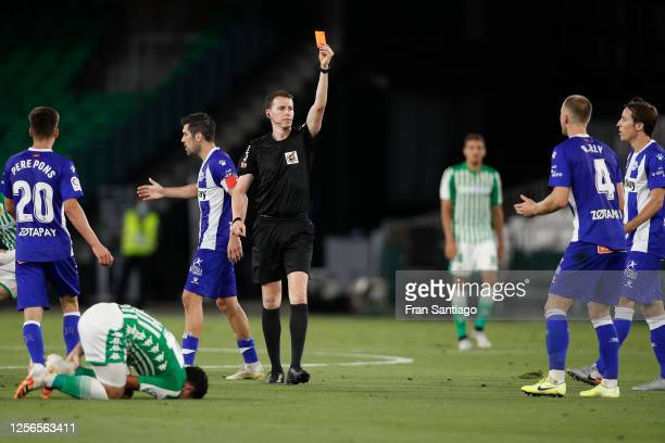 Referee David Medie Jimenez shows a red card to Rodrigo Ely of Deportivo Alaves during the Liga match between Real Betis Balompie and Deportivo...