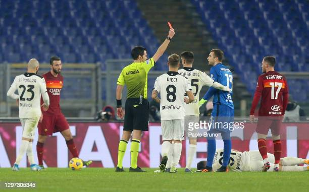 Referee, Davide Ghersini shows Pau Lopez of Roma a red card during the Coppa Italia match between AS Roma and AC Spezia at Olimpico Stadium on...