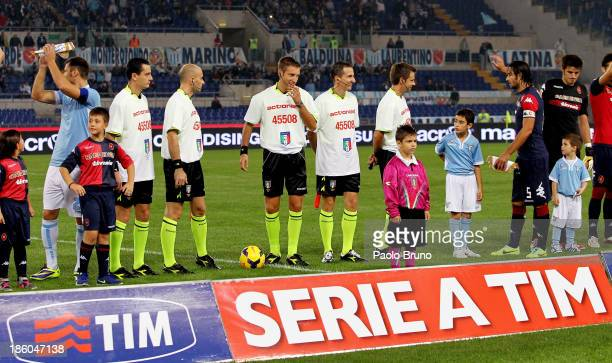 Referee Davide Massa and his assistants wear shirts featuring the logo of charity 'actonaid' before the start of the Serie A match between SS Lazio...