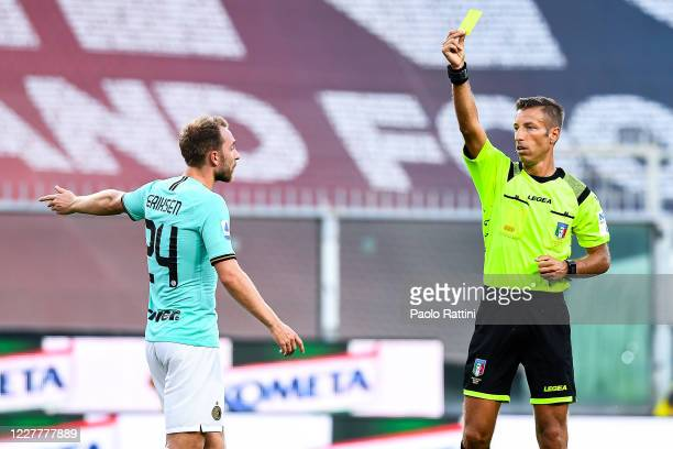 Referee Davide Massa shows Christian Eriksen of Inter a yellow card during the Serie A match between Genoa CFC and FC Internazionale at Stadio Luigi...