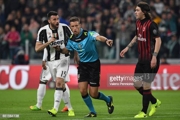 Referee Davide Massa signals a foul during the Serie A match between Juventus FC and AC Milan at Juventus Stadium on March 10 2017 in Turin Italy