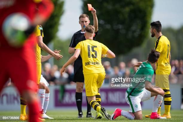 Referee DavidMarkus Koj shows Niclas Knoop of Dortmund the red card after a foul during the B Juniors German Championship Semi Final match between...