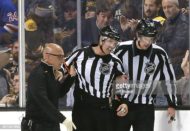 Referee Dean Morton leaves the game after an injury during a game between the New York Rangers and Boston Bruins in the second period at TD Garden on...