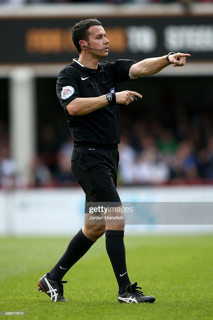 Referee Dean Whitestone makes a call during the Sky Bet Championship match between Brentford and Leeds United at Griffin Park on September 27, 2014 in Brentford, England.