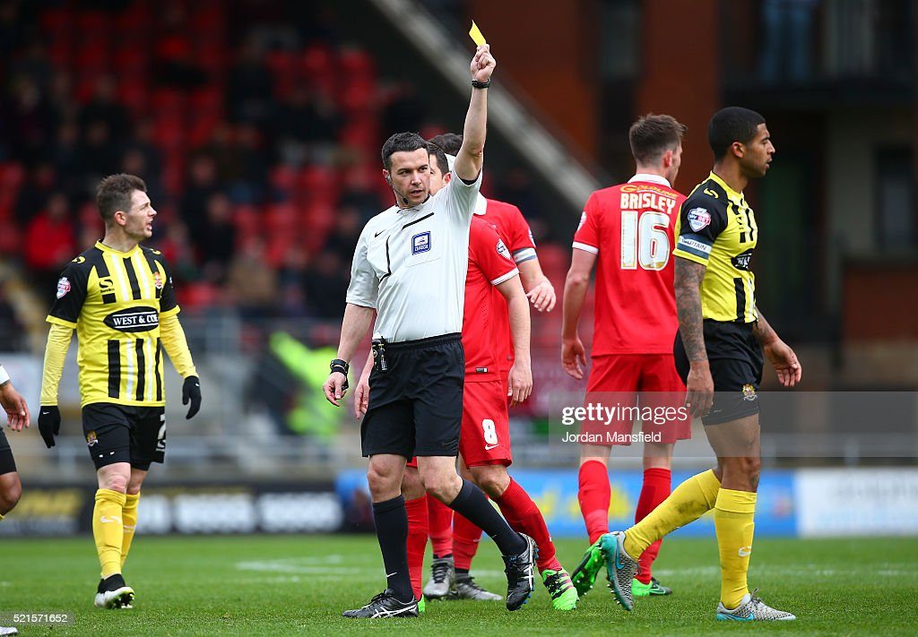 Referee Dean Whitestone shows a yellow card to Joss Labadie of Dagenham & Redbridge during the Sky Bet League Two match between Leyton Orient and Dagenham & Redbridge at Brisbane Road on April 16, 2016 in London, England.