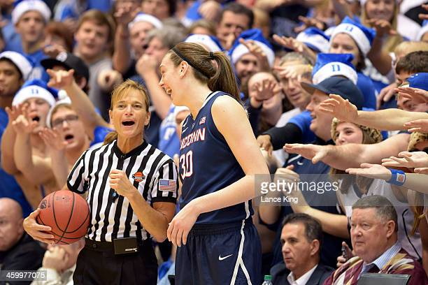Referee Dee Kantner and Breanna Stewart of the Connecticut Huskies share a laugh during their game against the Duke Blue Devils at Cameron Indoor...