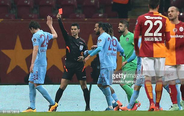 Referee Deniz Ates Bitnel shows a red cad to Salih Dursun of Trabzonspor after Dursun reacted to referee with a red card showing to referee during...