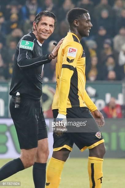Referee Deniz Aytekin and Peniel Mlapa of Dresden laugh during the Second Bundesliga match between SG Dynamo Dresden and FC St Pauli at DDVStadion on...