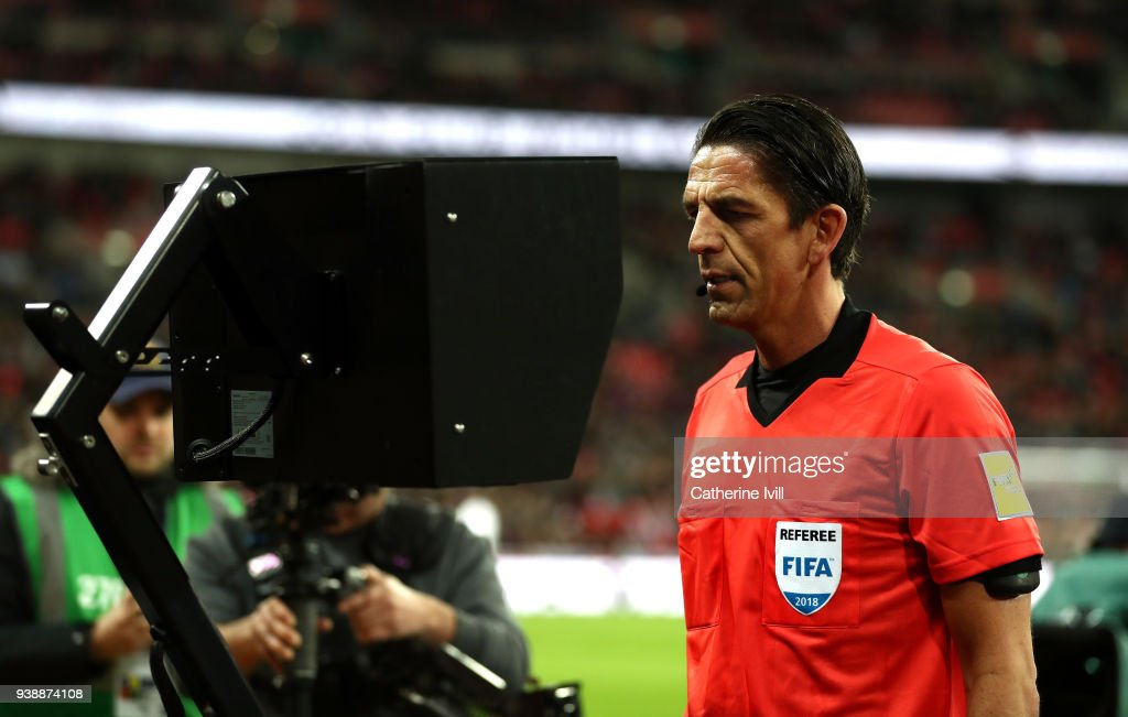 Referee Deniz Aytekin checks the VAR during the International friendly between England and Italy at Wembley Stadium on March 27, 2018 in London, England.