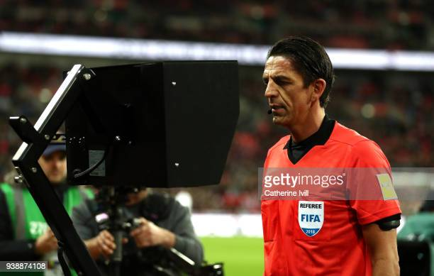 Referee Deniz Aytekin checks the VAR during the International friendly between England and Italy at Wembley Stadium on March 27 2018 in London England