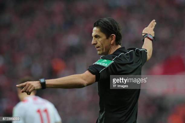 Referee Deniz Aytekin gestures during the Bundesliga match between 1 FC Koeln und TSG 1899 Hoffenheim at RheinEnergieStadion on November 5 2017 in...