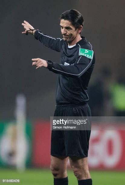 Referee Deniz Aytekin gestures during the DFB Cup quarter final match between Eintracht Frankfurt and 1 FSV Mainz 05 at CommerzbankArena on February...