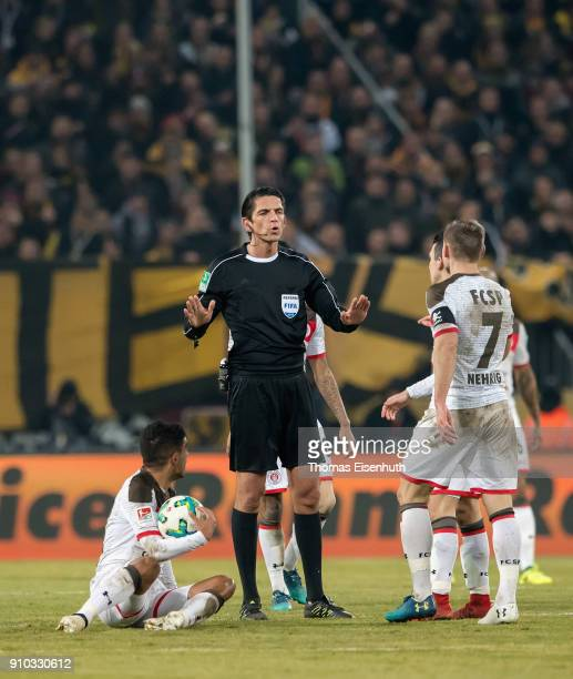 Referee Deniz Aytekin gestures during the Second Bundesliga match between SG Dynamo Dresden and FC St Pauli at DDVStadion on January 25 2018 in...