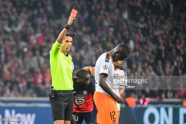 referee Deniz AYTEKIN gives a red card to Mouctar DIAKHABY of Valencia during the UEFA Champions League Group H match between Lille and Valencia on...