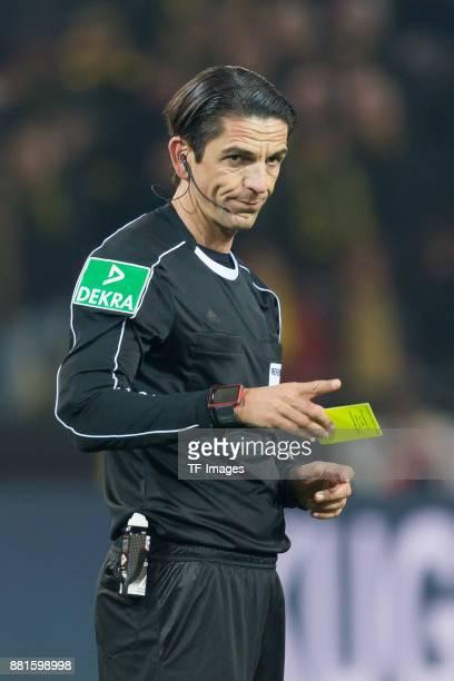 Referee Deniz Aytekin looks on during the Bundesliga match between Borussia Dortmund and FC Schalke 04 at Signal Iduna Park on November 25 2017 in...