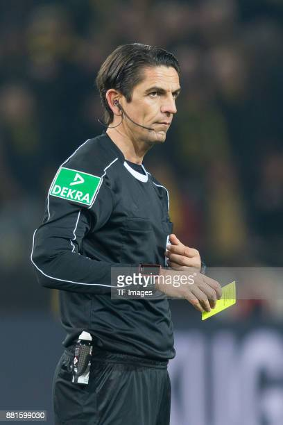 Referee Deniz Aytekin looks on during the Bundesliga match between Borussia Dortmund and FC Schalke 04 at Signal Iduna Park on November 25 2017 in...