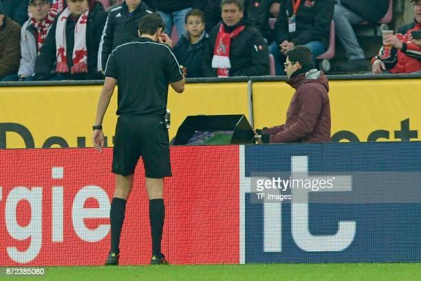 Referee Deniz Aytekin looks on screen during the Bundesliga match between 1 FC Koeln and TSG 1899 Hoffenheim at RheinEnergieStadion on November 5...