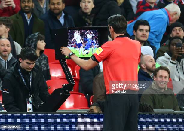 Referee Deniz Aytekin of Germay looking at the VAR to decided whether it's a penalty during International Friendly match between England against...