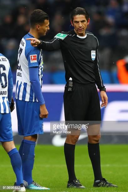 Referee Deniz Aytekin points to the penalty spot to award Hoffenheim a penalty as Davie Selke of Berlin looks at him during the Bundesliga match...