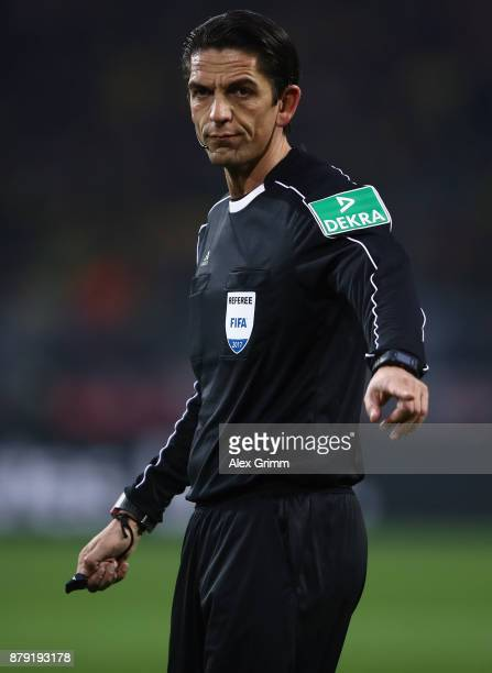 Referee Deniz Aytekin reacts during the Bundesliga match between Borussia Dortmund and FC Schalke 04 at Signal Iduna Park on November 25 2017 in...