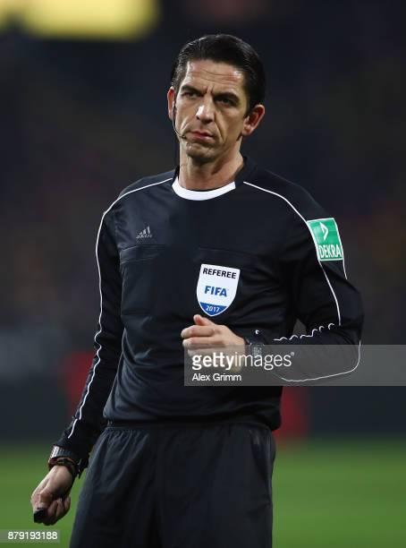 Referee Deniz Aytekin reacts during the Bundesliga match between Borussia Dortmund and FC Schalke 04 at Signal Iduna Park on November 25 2017 in...