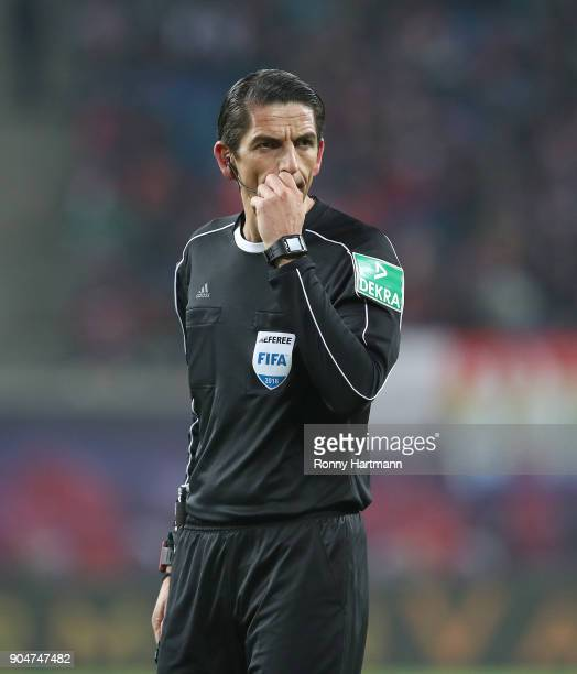 Referee Deniz Aytekin reacts during the Bundesliga match between RB Leipzig and FC Schalke 04 at Red Bull Arena on January 13 2018 in Leipzig Germany