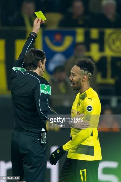 Referee Deniz Aytekin show PierreEmerick Aubameyang of Dortmund the yellow card during the Bundesliga match between Borussia Dortmund and FC Schalke...