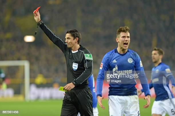 Referee Deniz Aytekin show PierreEmerick Aubameyang of Dortmund the red card during the Bundesliga match between Borussia Dortmund and FC Schalke 04...