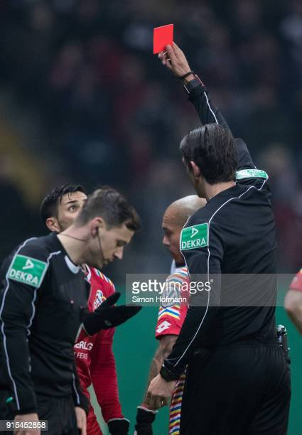 Referee Deniz Aytekin shows the red card to Danny Latza of Mainz during the DFB Cup quarter final match between Eintracht Frankfurt and 1 FSV Mainz...