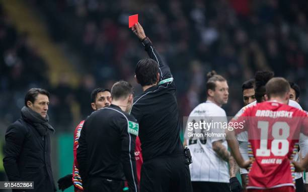 Referee Deniz Aytekin shows the red card to Danny Latza of Mainz during the DFB Cup quarter final match between Eintracht Frankfurt and 1 FSV Mainz...