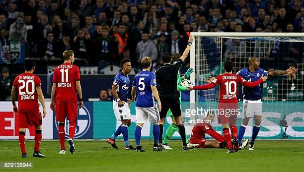 Referee Deniz Aytekin shows the red card to Naldo of Schalke during the Bundesliga match between FC Schalke 04 and Bayer 04 Leverkusen at...
