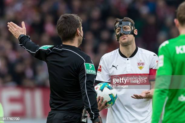 Referee Deniz Aytekin speak with Christian Gentner of Stuttgart during the Bundesliga match between VfB Stuttgart and Borussia Moenchengladbach at...