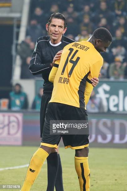 Referee Deniz Aytekin speaks with Peniel Mlapa of Dresden during the Second Bundesliga match between SG Dynamo Dresden and FC St Pauli at DDVStadion...