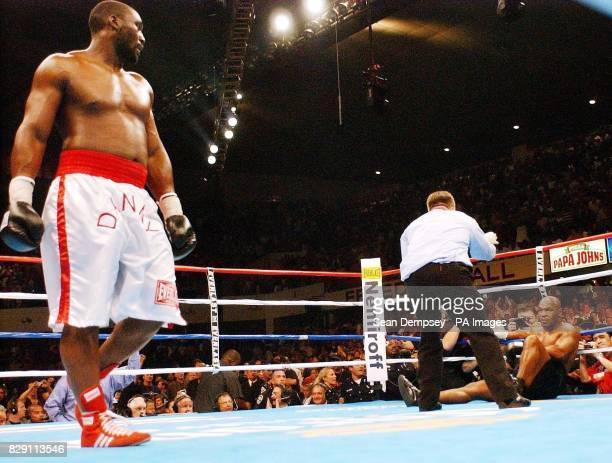 Referee Dennis Alfred counts out America's Mike Tyson after he is knocked out by England's Danny Williams in the fourth round of their heavyweight...