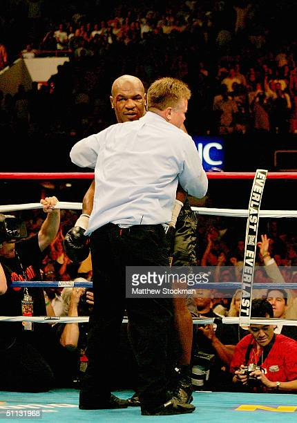 Referee Dennis Alfred counts out Mike Tyson in the fourth round against Danny Williams of Great Britain July 30 2004 at Freedom Hall in Louisville...
